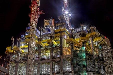 Photo for Building skyscraper at construction process during night. - Royalty Free Image