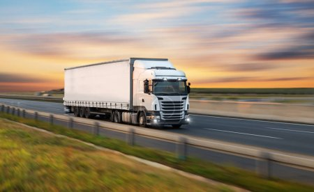 Photo for Truck with container on highway, cargo transportation concept. Shaving effect. - Royalty Free Image