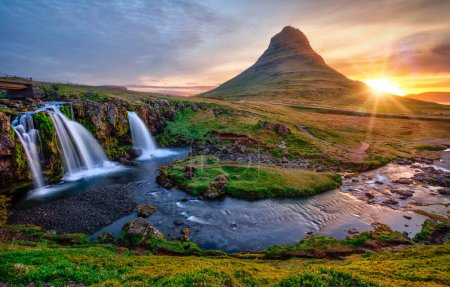 Photo for Beautiful landscape with sunrise on Kirkjufellsfoss waterfall and Kirkjufell mountain, Iceland, Europe. - Royalty Free Image