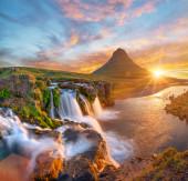 Beautiful landscape with sunrise on Kirkjufellsfoss waterfall and Kirkjufell mountain, Iceland.