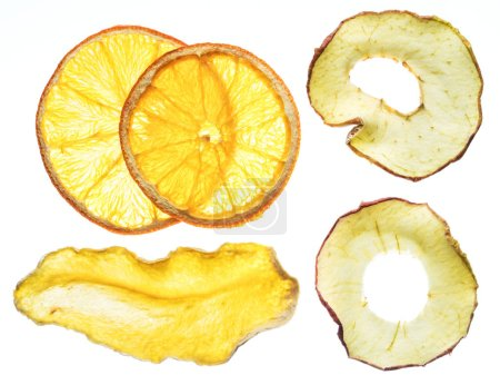 Dried orange and apple slices isolated on white background. Organic food.