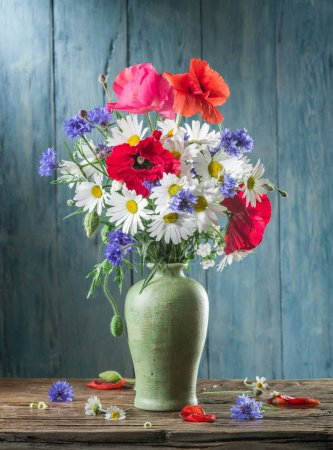 Photo for Bouquet of field flowers in the vase on the wooden table. - Royalty Free Image