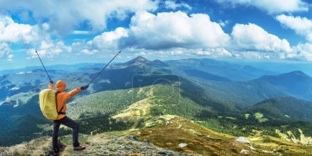 Photo for Hiker enjoying the trip in the top of mountain. - Royalty Free Image