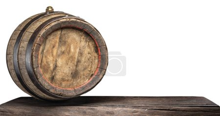 Wine barrel on the old wooden table. File contains clipping path.