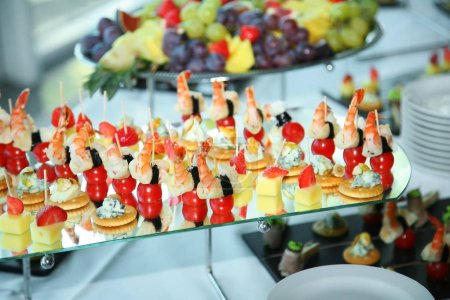 Different fruits and light appetizers provided during catered events. Close-up.