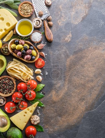 Photo for Pasta, spices and vegetables. Popular mediterranean or italian food ingredients. Top view. - Royalty Free Image