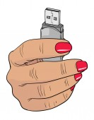 Woman hand holding up a flash disk