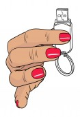 Woman hand holding up a flash drive