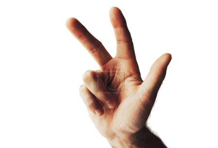 Photo pour Plan recadré de la main montrant trois doigts isolés sur blanc - image libre de droit
