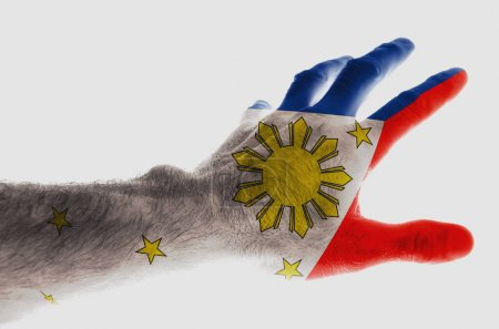 Photo pour Mature male hand painted in the colors of the Philippine flag Image dedicated to the national holiday of the Philippines - Independence Day on June 12 Isolated on white background. - image libre de droit