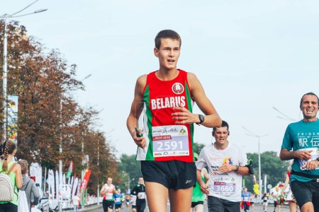 Photo for September 9, 2018 Minsk Belarus A marathon race in which a close-up of a marathon runner crosses the finish line ahead of the participants - Royalty Free Image