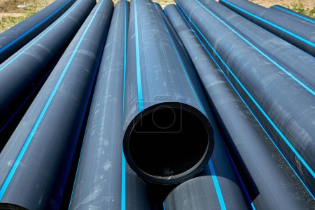 Photo for Polyethylene pressure pipes for cold water pipes are used for installation - Royalty Free Image