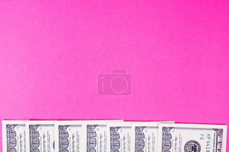 Some dollars of america isolated on pink backgroun...