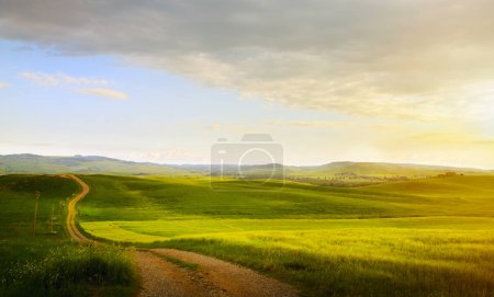 Photo for Spring farmland and country road;  tuscany countryside rolling hills - Royalty Free Image