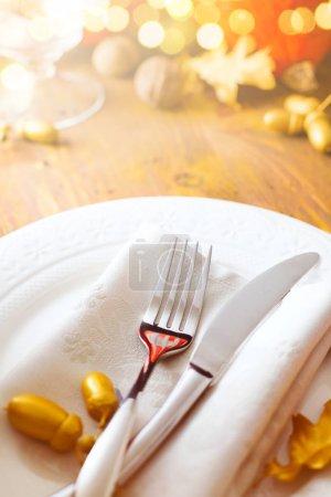 Foto de Autumn Thanksgiving dinner table setting with pumpkins and silverware. - Imagen libre de derechos
