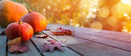 Foto de Autumn pumpkin on wooden table; thanksgiving holiday party background, - Imagen libre de derechos