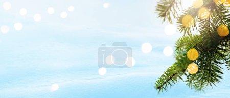 Foto de Christmas background. Xmas tree with garland lights holiday decoration, snowy holiday festive backdround. Banner Widescreen frame backdrop. New year Winter Christmas scene design - Imagen libre de derechos