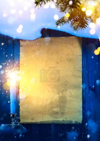 Foto de Christmas and New Year party invitation;  greeting card background, snow covered paper scrol - Imagen libre de derechos