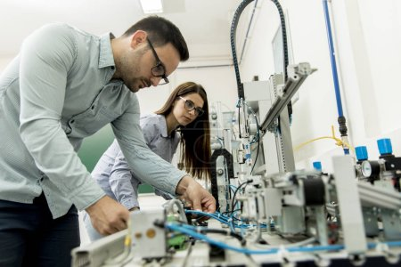 Photo for Portrait of young couple of students working at robotics lab - Royalty Free Image