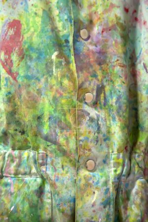 Closeup of the dirty coat with colorful paint stains
