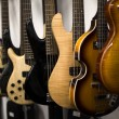 Clolection of electric guitars hanging in shop...