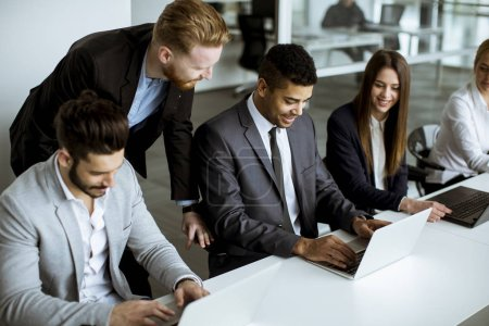 Photo for Group of  multiethnic business people sharing their ideas in the office - Royalty Free Image
