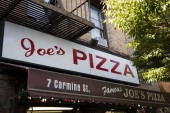 NEW YORK, USA - AUGUST 30, 2017: Detail of the Joe's Pizza restaurant in New York. It well known pizza establishment on Carmine Street in Greenwich Village in New York City