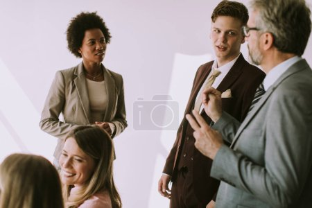 Photo for Group of multiethnic business people working on new project in the modern office - Royalty Free Image