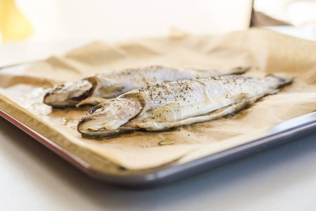tasty baked fish on parchment paper