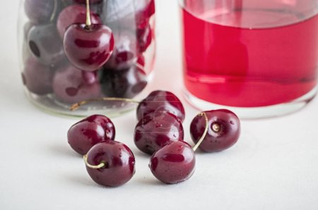 Photo for Glass of fresh cherry juice close up - Royalty Free Image
