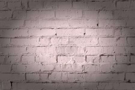 Empty brown background, dark beige brick wall. Texture of masonry. Beautiful pattern with vignette.