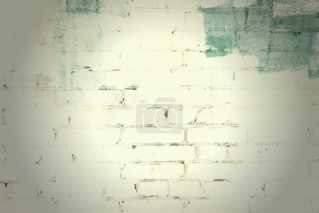 Photo for Brick wall painted with yellow and green paint. Unusual background with vignette and place for text, texture. - Royalty Free Image