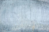 Old wall with stains and smudges. The texture of bluish slate. A close-up photo.