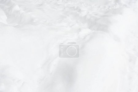 Photo of freshly fallen snow. Small drifts after a blizzard.