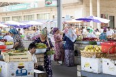 MARGILAN, UZBEKISTAN - AUGUST 24, 2018: People at local fruit and vegetables bazaar - Margilan near Fergana, Uzbekistan.