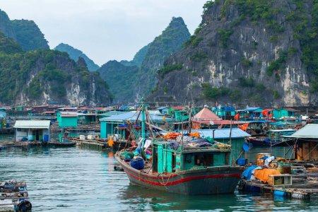 Photo for HA LONG BAY, VIETNAM - NOVEMBER 13, 2018: Halong Bay, Vietnam. Unesco World Heritage Site. Traditional tourist boats. - Royalty Free Image