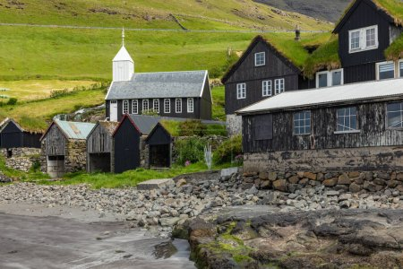 Photo for Bour village. Typical grass-roof houses and green mountains. Vagar island, Faroe Islands. Denmark. Europe. - Royalty Free Image