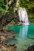 Waterfall in Thailand name Erawan, forest environment with big tree
