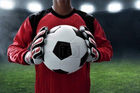 Soccer goalkeeper holding soccer ball