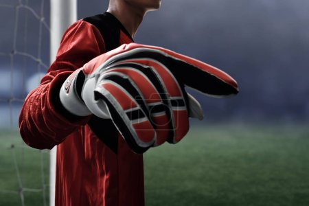 Soccer goalkeeper gloves on the field
