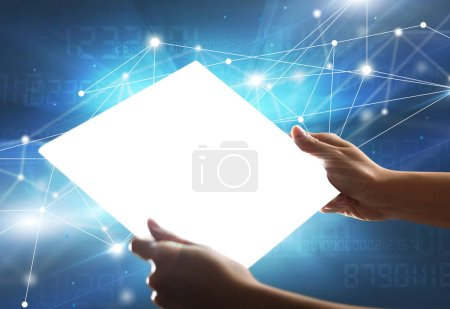 Photo for Young female hand holding a tablet with numbers in the background - Royalty Free Image