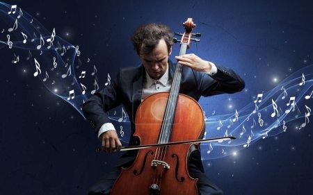 Photo pour Compositeur de musique solitaire avec violoncelle et des notes de musique pétillantes autour - image libre de droit