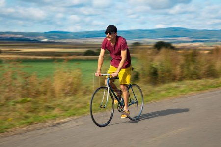 Photo for Natural view with cyclist going somewhere with stylish bike - Royalty Free Image