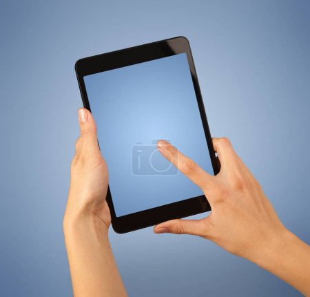 Photo for Female fingers touching blank tablet - Royalty Free Image