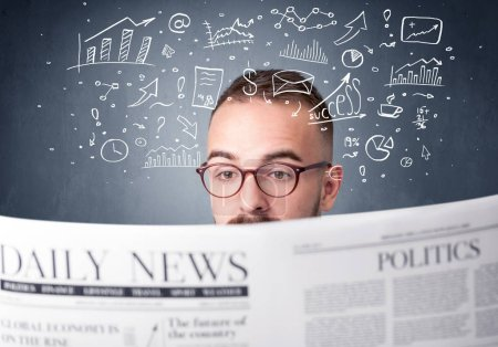 Photo for Young smart businessman reading daily newspaper with business plan graphics above his head - Royalty Free Image