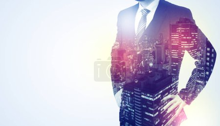 Photo for Young businessman standing and thinking with night city background - Royalty Free Image