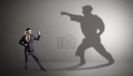 Photo for Young karate man confronting with his own shadow - Royalty Free Image