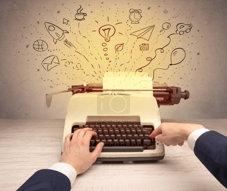 Photo pour Machine à écrire avec gribouillis, idée, message, avion, ballon de voiture concept de médias sociaux - image libre de droit