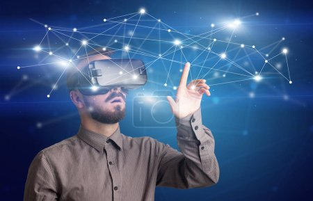 Photo for Amazed businessman with virtual reality network concept in front of him - Royalty Free Image