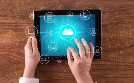 Photo for Hand touching tablet with cloud computing and online storage concept - Royalty Free Image